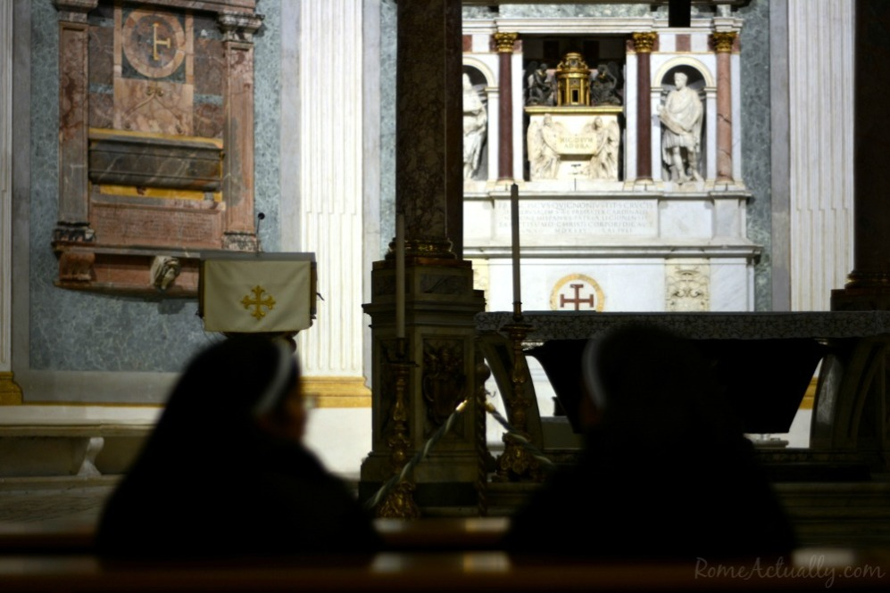 Nuns chattering... erm... praying in front of the main altar