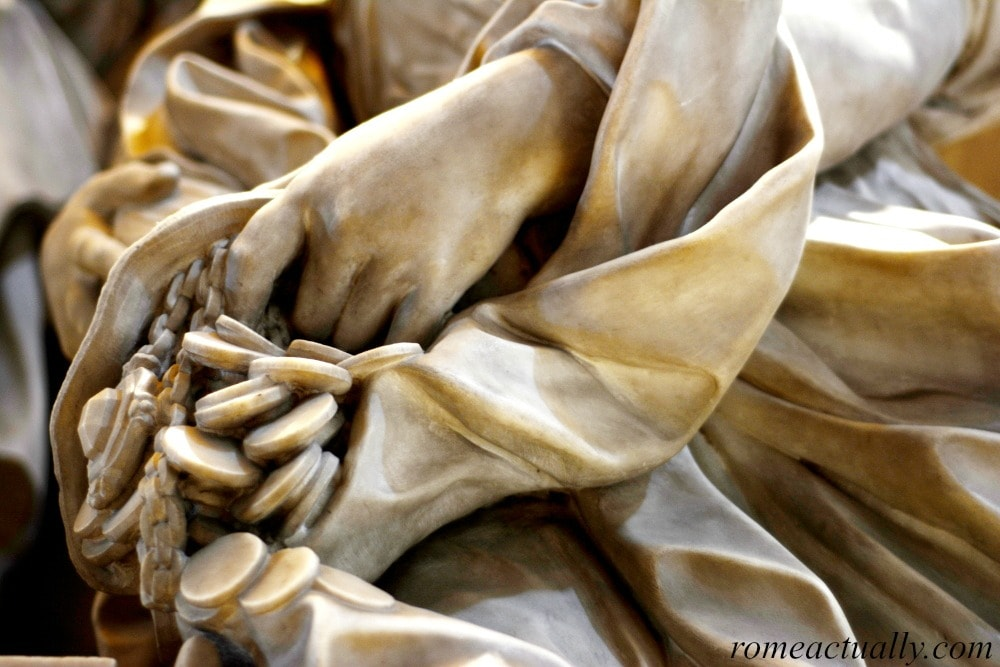 Visiting the Vatican City, detail of sculpture in St. Peter Basilica